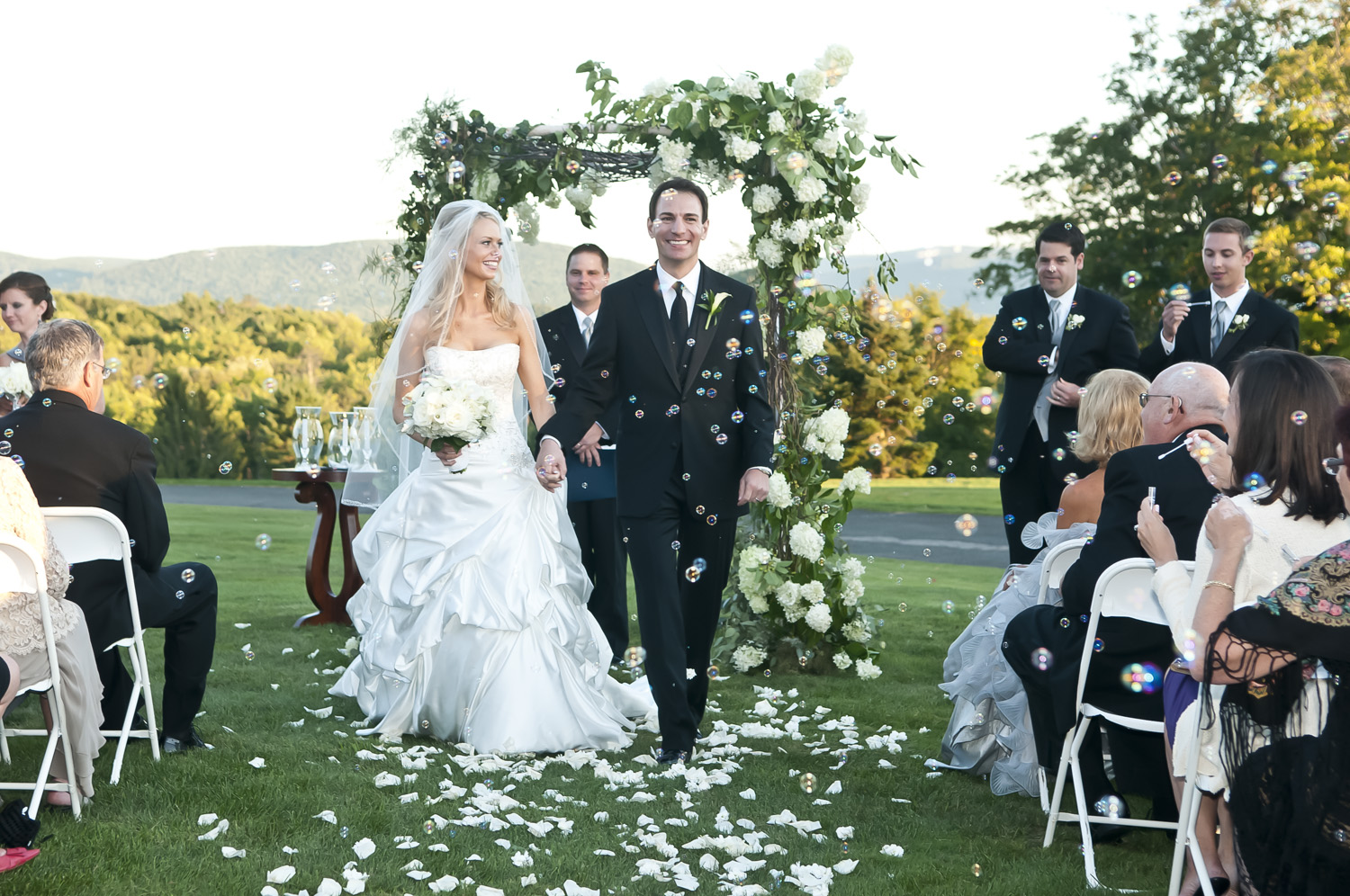wedding-bride-groom-mountains-bubbles-flowers-petals